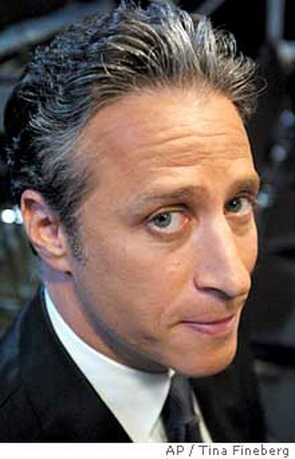 """**FILE**Jon Stewart poses on the set of Comedy Central's """"The Daily Show"""" in New York on July 23, 2003. (AP Photo/Tina Fineberg) Photo: TINA FINEBERG"""