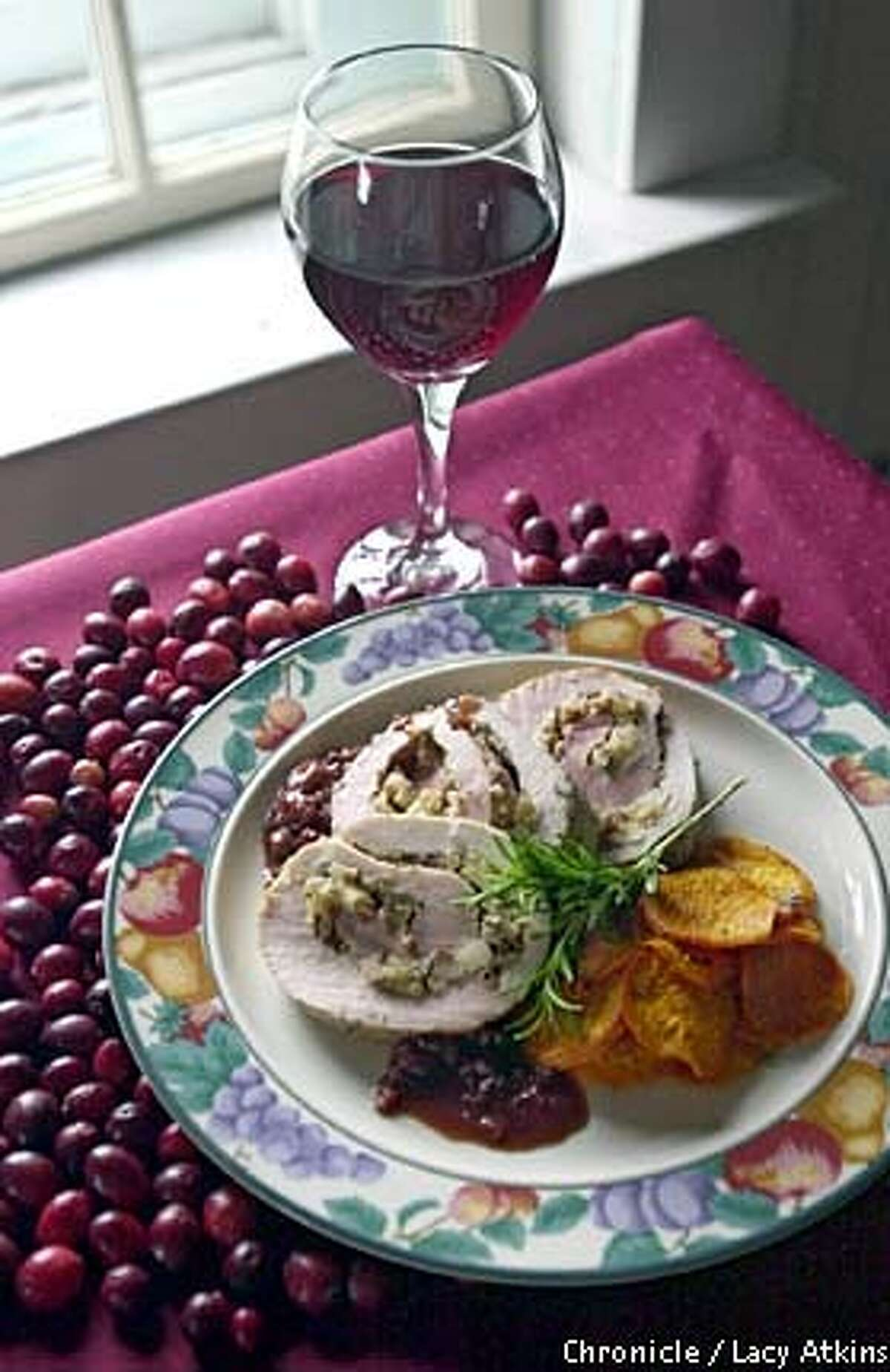 Festive: Tangy dried cranberries star in a sauce for a rolled stuffed pork loin. Chronicle photo by Lacy Atkins