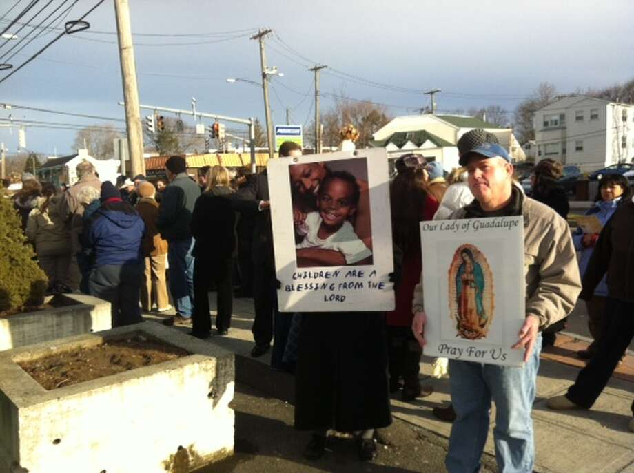For nearly two hours Saturday morning, 200 anti-abortion supporters gathered near the Summit Women s Center at 3787 Main St. in Bridgeport to condemn abortion and pray for its abolition. Photo: Michael Mayko