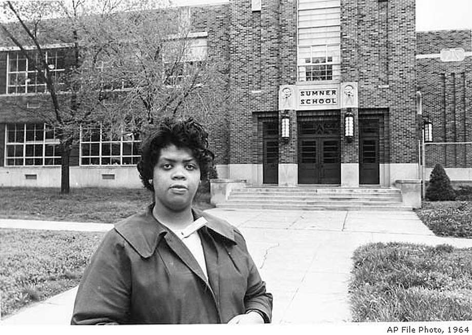 ** FILE ** Linda Brown Smith stands in front of the Sumner School in Topeka, Kan., in this May 8, 1964 file photo. The refusal of the public school to admit Brown in 1951, then nine years old, because she is black, led to the Brown v. Board of Education of Topeka, Kansas. The landmark case was decided by the U.S. Supreme Court 50 years ago and will be commerated with the opening of an new National Historic Site at Monroe School May 17. (AP Photo) MAY 8, 1964 FILE PHOTO, BLACK AND WHITE IMAGE ONLY