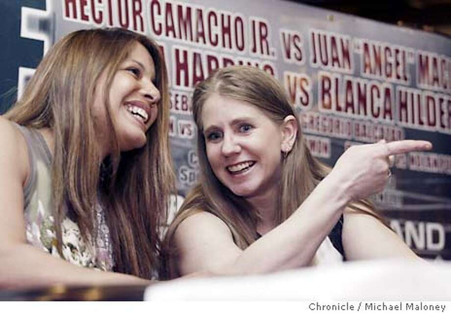 Tonya Harding (right) appeared at a press conference at SF's Pier 39 Hard Rock Cafe to promote her Saturday bout against Pacifica resident Blanca Gutierrez-Hilder (left) in a boxing card at the Oakland Arena. Also appearing AT PC was Hector Camacho Jr., who will also be fighting on the Saturday card.  Photo by Michael Maloney / The Chronicle Photo: Michael Maloney