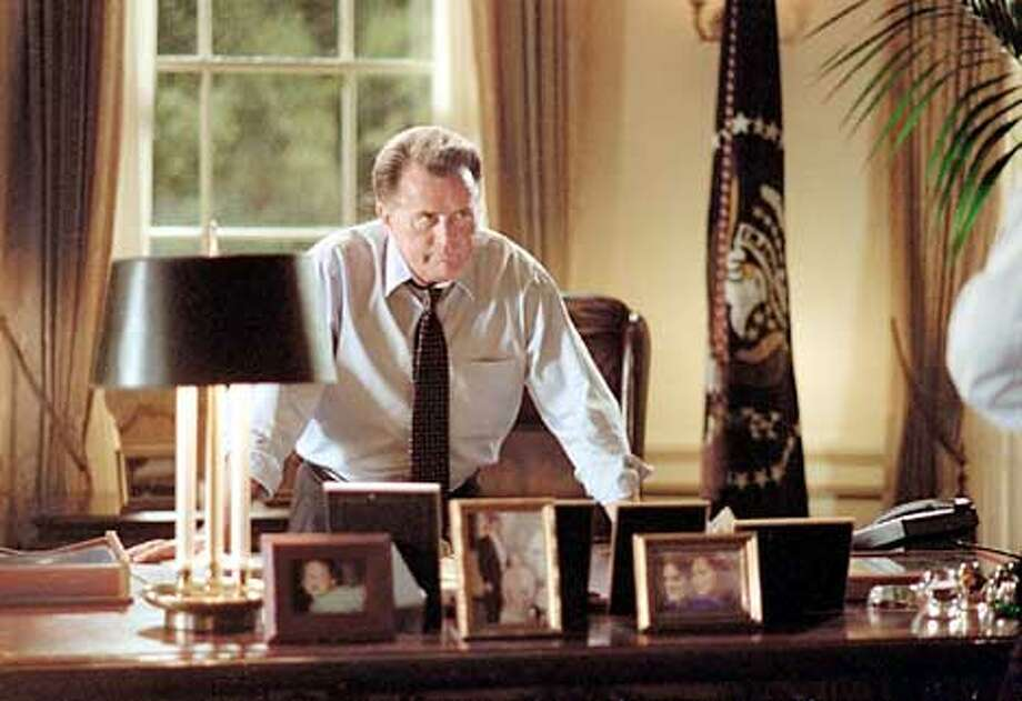 """THE WEST WING -- NBC Series -- """"War Crimes"""" -- Pictured: Martin Sheen as President Josiah Bartlett -- PRESIDENT BARTLETT REFLECTS ON THE GUN CONTROL ISSUE AFTER HEARING OF CHURCH SHOOTING IN TEXAS -- Warner Bros. photo Photo: HANDOUT"""