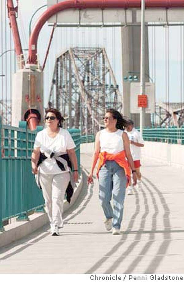"at left is Lisa Sharrock of Rodeo with friend Cindy Arbizo of Vallejo. Came to take a walk the first day and said, "" It's fabulous, we love the views."" The Zampa Bridge opened up today to pedestrians and bike riders.  on 5/16/04 in Crockett, CA.  must credit photo by Penni Gladstone/ Photo: Penni Gladstone"
