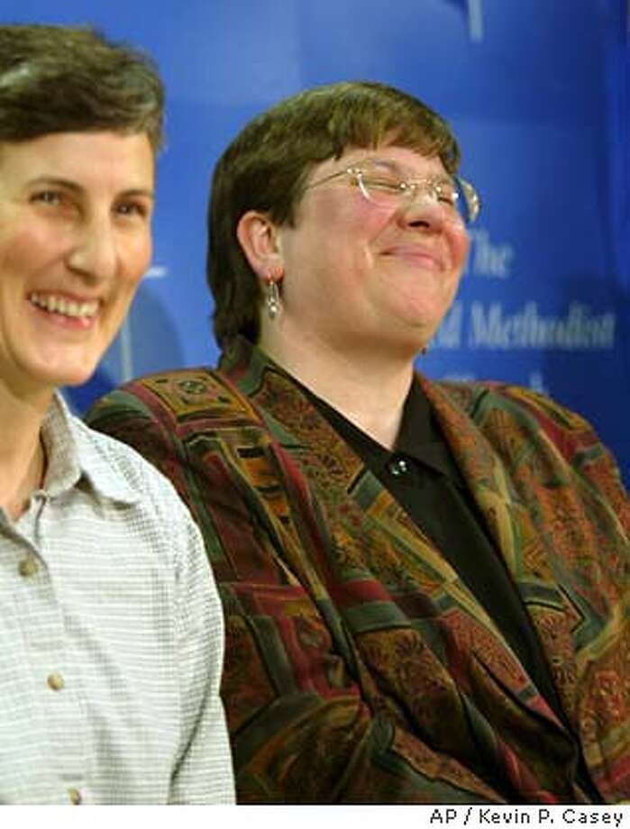 Meredith Savage(left) laughs with her partner Rev. Karen Dammann at a press conference in Bothell on Saturday March 20, 2004, after the United Methodist Church decided Damman was not guilty of violating church laws by practicing homosexuality.(AP Photo/Kevin P. Casey) Photo: Kevin P. Casey