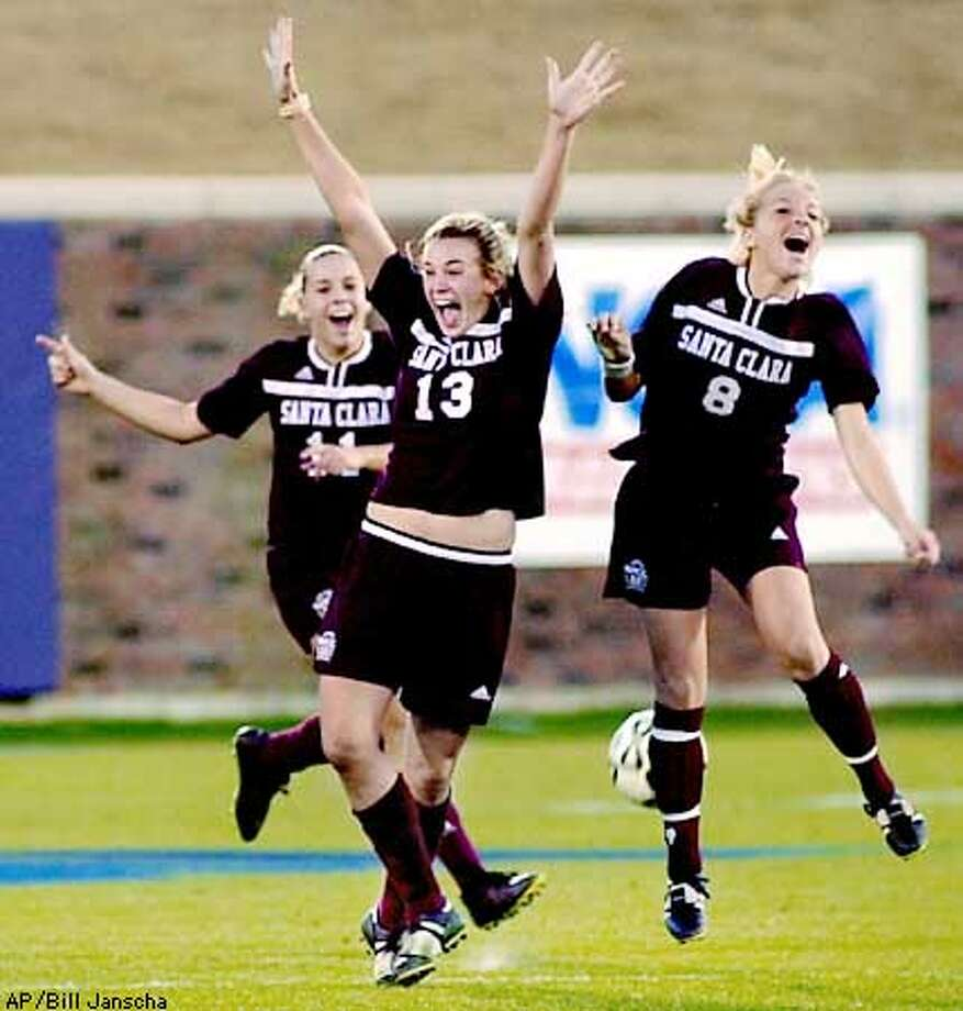 Santa Clara's Devvyn Hawkins (13), Jessica Ballweg (11) and Anna Kraus (8) celebrate their 1-0 win over North Carolina at the NCAA Women's College Cup championship game in Dallas, Sunday, Dec. 9, 2001. (AP Photo/Bill Janscha) Photo: BILL JANSCHA