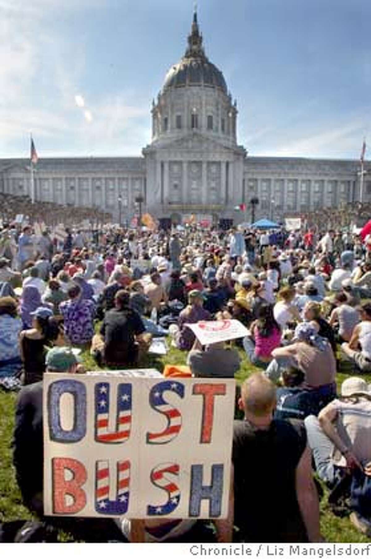 Protestors listen to speakers and music at the civic center after the march. Photo taken on 03/20/04 in San Francisco, CA Photo by Liz Mangelsdorf/ The San Francisco Chronicle.