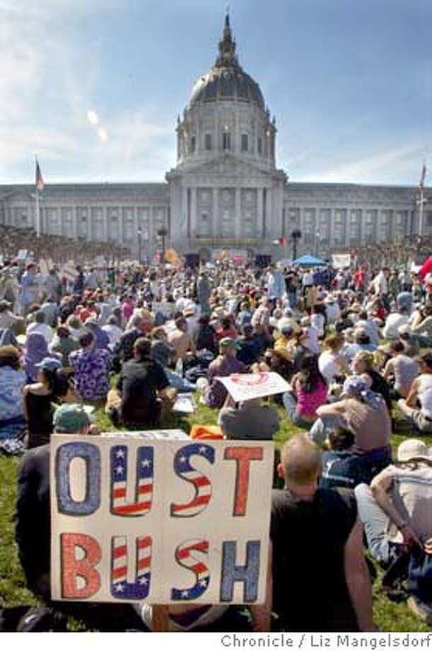 Protestors listen to speakers and music at the civic center after the march.  Photo taken on 03/20/04 in San Francisco, CA Photo by Liz Mangelsdorf/ The San Francisco Chronicle. Photo: Liz Mangelsdorf
