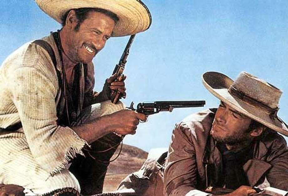"Eli Wallach, right, and Clint Eastwood are pictured in ""The Good, the Bad and the Ugly."" The late award winning actor was a graduate of the University of Texas, one of many famous Longhorns. Look back at some of the other famous Americans to come out of Austin.  Photo: Handout"