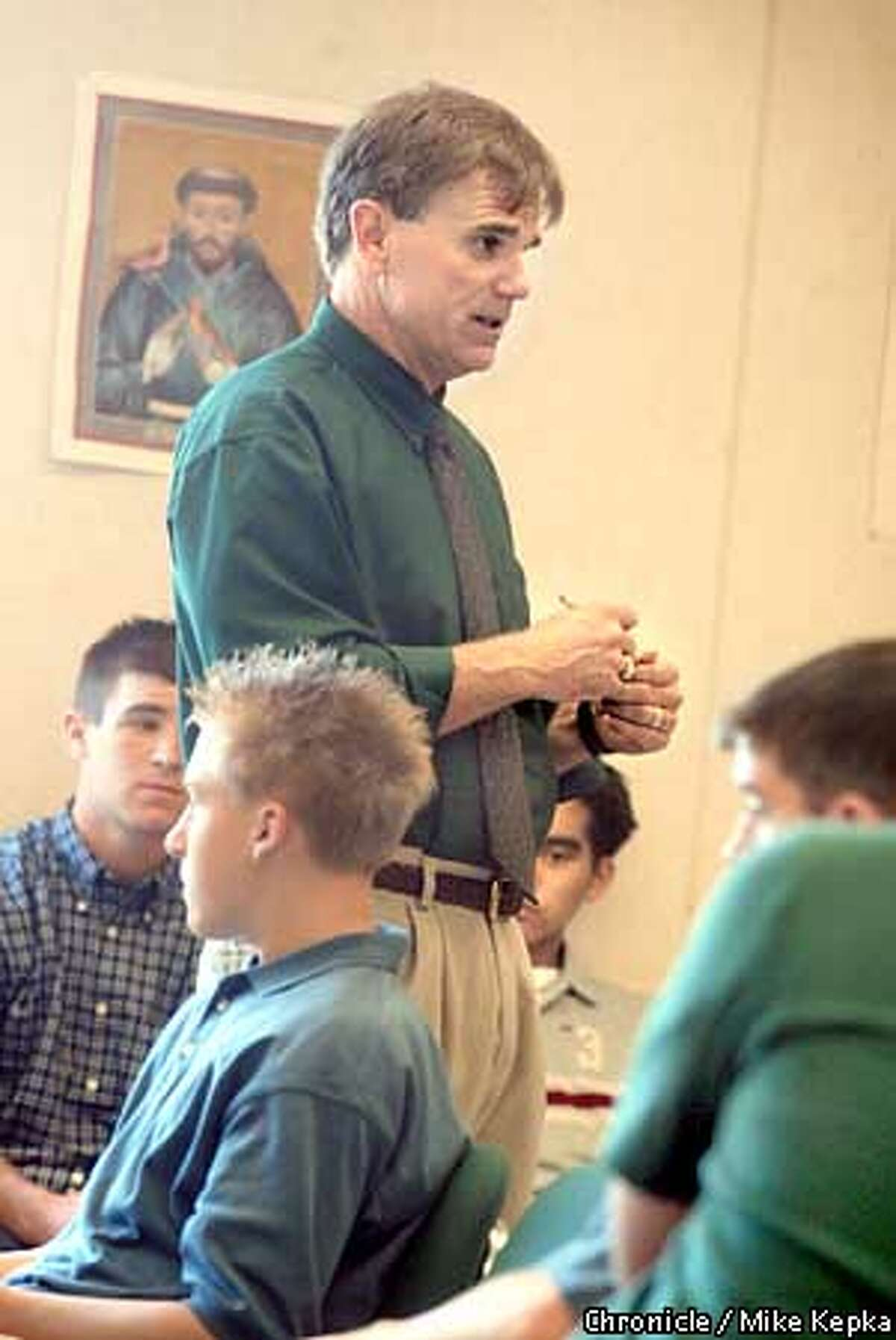 On the first day of school, De La Salle teacher and Coach Bob Ladoucer encourages a handfull of seniors taking his religion class to feel free to express themselves in his classroom. Bob Ladoucer knows the how to put together a winning combination. His team hasn't lost a game in ten years. BY MIKE KEPKA/THE CHRONICLE
