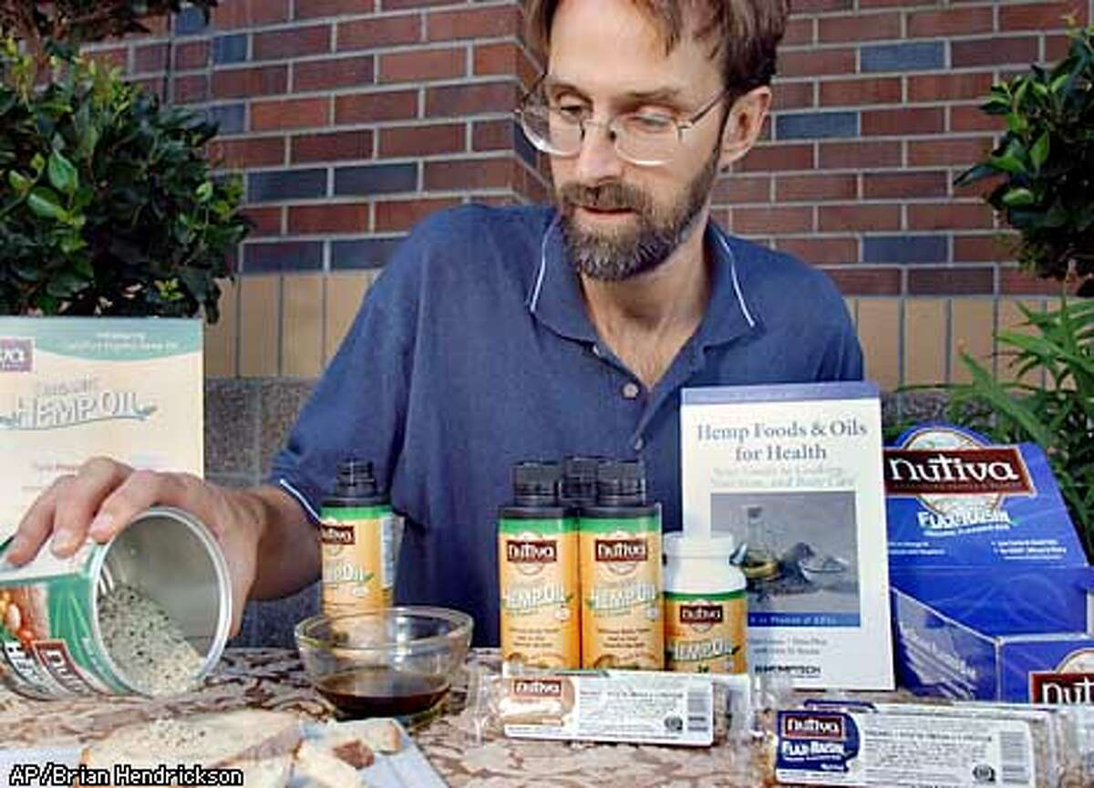 Nutiva founder and president John Roulac demonstrates his company's hempseed-based products in Hillsboro, Ore. on Saturday, Aug. 17, 2002. Nutiva has experienced hempseed supply problems due to the federal government's war on drugs. (Photo by Brian Hendrickson)