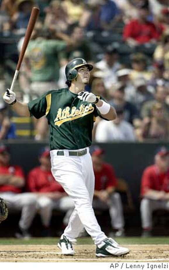 Oakland Athletics' Eric Chavez watches his first-inning home run against the Anaheim Angels on Friday, March 19, 2004, in Phoenix. Chavez signed a six-year, $66 million contract extension this week. (AP Photo/Lenny Ignelzi) Photo: LENNY IGNELZI