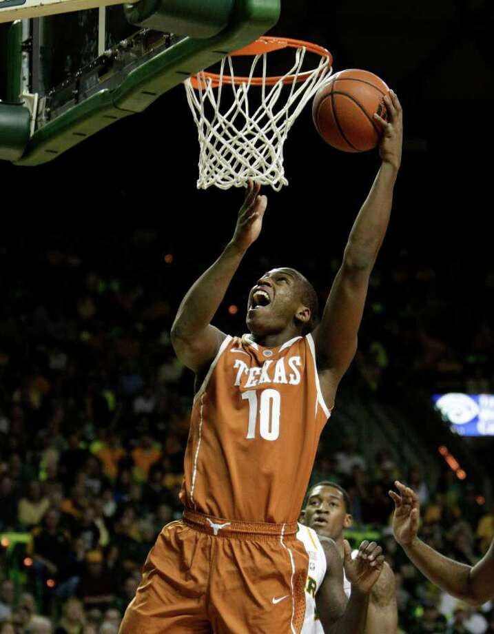 Texas 's Jonathan Holmes (10) attempts a shot in the first half of an NCAA basketball game against Baylor  Saturday, Jan. 28, 2012, in Waco, Texas. (AP Photo/Tony Gutierrez) Photo: Tony Gutierrez, Associated Press / AP