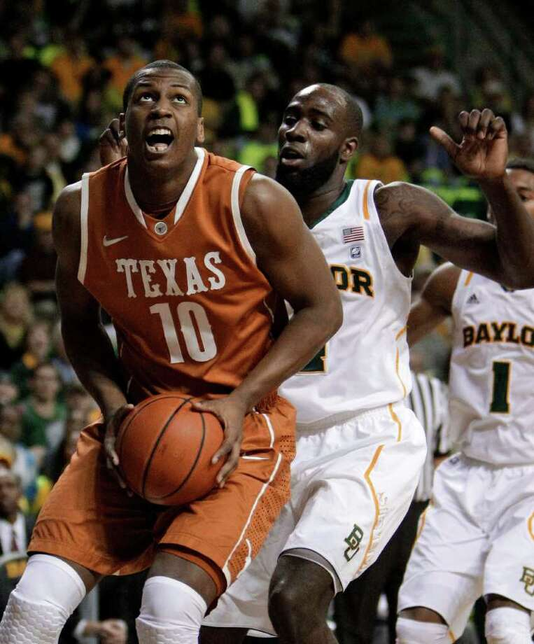 Texas's Jonathan Holmes (10) positions for a shot attempt as Baylor 's Quincy Acy, right, defends in the first half of an NCAA basketball game Saturday, Jan. 28, 2012, in Waco, Texas. (AP Photo/Tony Gutierrez) Photo: Tony Gutierrez, Associated Press / AP
