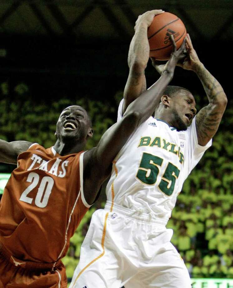 Baylor guard Pierre Jackson (55) gabs a rebound in front of Texas's Alexis Wangmene (20) of Cameroon, in the first half of an NCAA basketball game Saturday, Jan. 28, 2012, in Waco, Texas. (AP Photo/Tony Gutierrez) Photo: Tony Gutierrez, Associated Press / AP