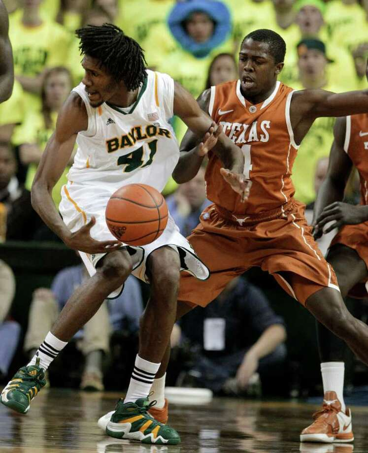 Baylor 's Anthony Jones (41) loses the ball as Texas 's J'Covan Brown (14) defends in the first half of an NCAA basketball game Saturday, Jan. 28, 2012, in Waco, Texas. (AP Photo/Tony Gutierrez) Photo: Tony Gutierrez, Associated Press / AP