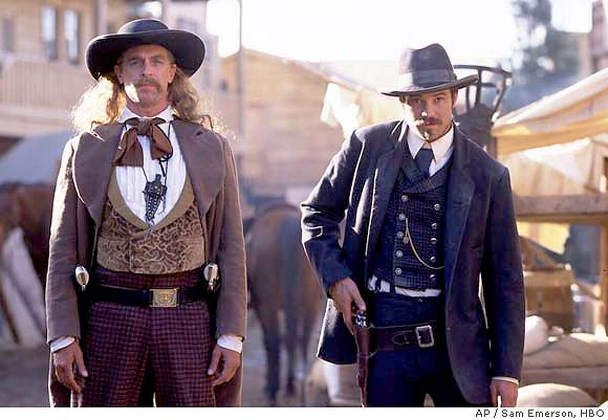 """Keith Carradine, left, as the legendary gunslinger """"Wild Bill"""" Hickok and Timothy Olyphant appear in this scene from HBO's """"Deadwood,"""" in this undated publicity photo. The series premieres Sunday, March 21, 2004 at 10 p.m. EST. (AP Photo/HBO, Sam Emerson)"""