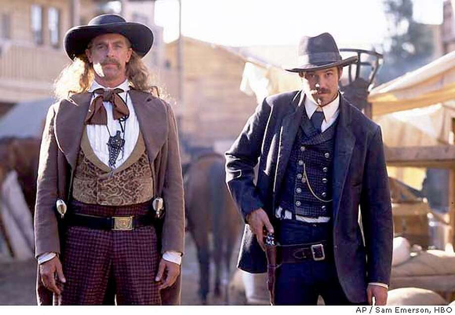 "Keith Carradine, left, as the legendary gunslinger ""Wild Bill"" Hickok and Timothy Olyphant appear in this scene from HBO's ""Deadwood,"" in this undated publicity photo. The series premieres Sunday, March 21, 2004 at 10 p.m. EST. (AP Photo/HBO, Sam Emerson) Photo: SAM EMERSON"