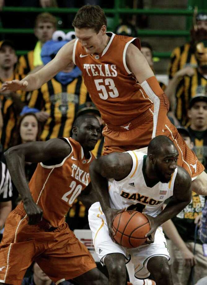 Baylor 's Quincy Acy (4) is fouled by Texas 's Clint Chapman (53) as Alexis Wangmene (20) of Cameroon, looks on during the first half of an NCAA college basketball game Saturday, Jan. 28, 2012, in Waco, Texas. (AP Photo/Tony Gutierrez) Photo: Tony Gutierrez, Associated Press / AP