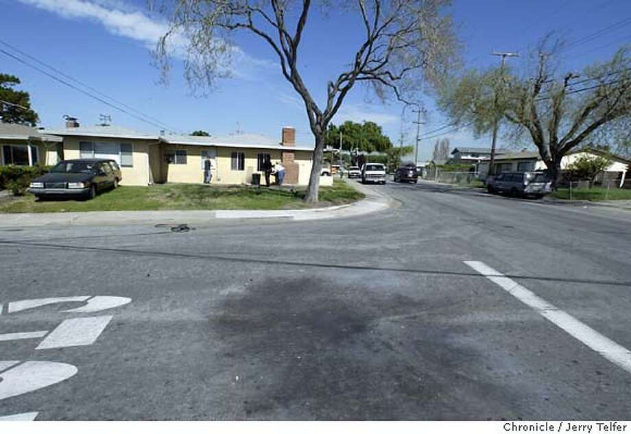 hayward19_009_jlt.jpg Broken windows in five houses and a blast scorch in the street resulted from the detonation of a bomb thrown from a car at about 6:15am Thursday morning at the intersection of Thelma and Sueirro Streets in an otherwise quiety residential neighborhood of Hayward, CA. CHRONICLE PHOTO BY JERRY TELFER Event on 3/18/04 in Hayward. Jerry Telfer / The Chronicle Photo: Jerry Telfer