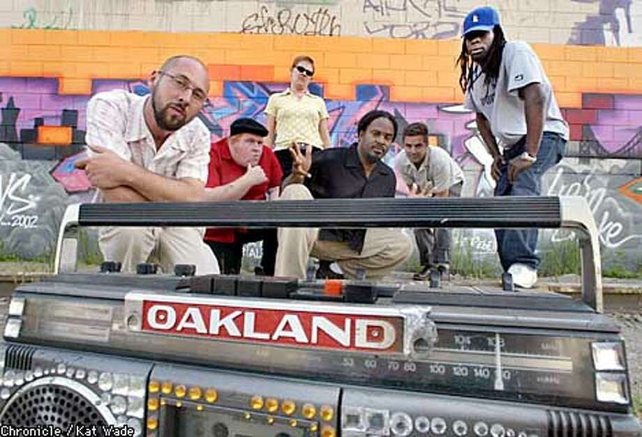 Members of the Nonchalance Collective, Jeff Hull, Sean and Katie Aaberg (cq) , Refa1, Geoff (CQ) St.John, and Kemrexx, who make art of and about Oakland, pose in front of a recent mural called Mural Renegades of Funk painted by aerosal artists, Refa1, Lucha, Wicks and Beats, at the Colesium Yard in Oakland. SAN FRANCISCO CHRONICLE PHOTO BY KAT WADE Photo: KAT WADE