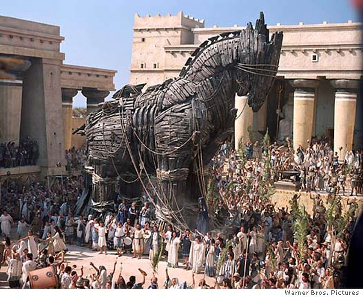 """A Trojan horse is shown in a scene from the new action film """"Troy"""" starring Brad Pitt, in this undated publicity photograph. The film opens May 14, 2004 in the United States. REUTERS/Warner Bros/Handout"""
