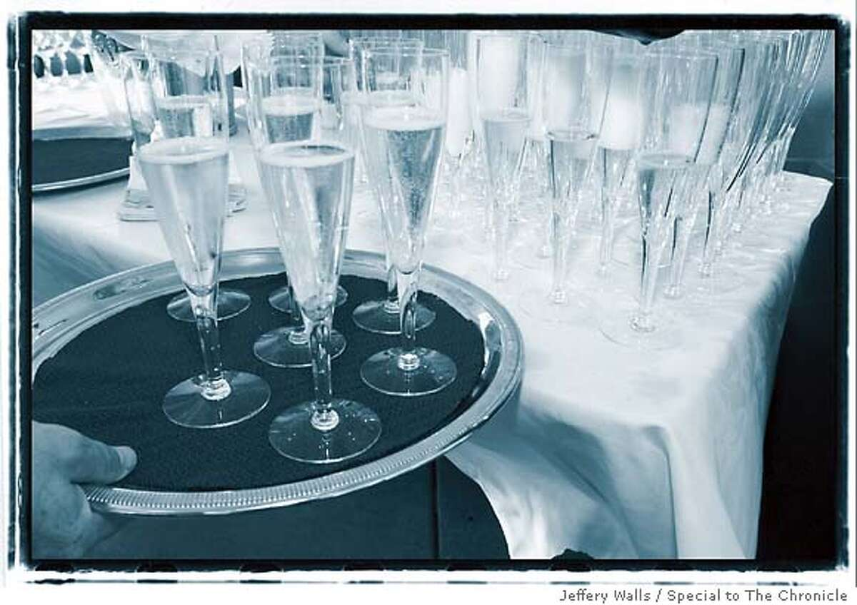 A Champagne toast and cake are the highlights of most weddings. Photo by Jeffery Walls, special to the Chronicle
