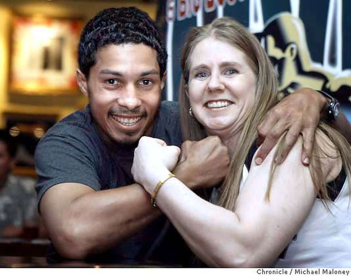 Camacho and Harding flex their muscles for the camera. Tonya Harding appeared at a press conference at SF's Pier 39 Hard Rock Cafe to promote her Saturday bout against Pacifica resident Blanca Gutierrez-Hilder in a boxing card at the Oakland Arena. Also appearing at the pc was Hector Camacho Jr., who will also be fighting on the Saturday card. Photo by Michael Maloney / The Chronicle