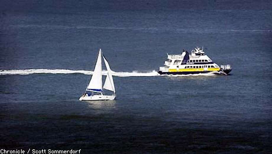 A blue and gold ferry passes a sailboat on its way to docking in SF at the Ferry Plaza. (SF CHRONICLE PHOTO BY SCOTT SOMMERDORF) Photo: SCOTT SOMMERDORF