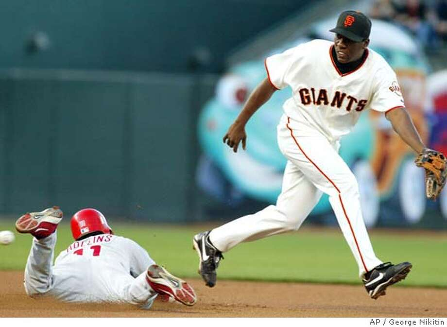 Philadelphia Phillies' Jimmy Rollins steals second as the ball gets by San Francisco Giants' Deivi Cruz Tuesday May 11, 2004, in San Francisco. (AP Photo/George Nikitin) Photo: GEORGE NIKITIN