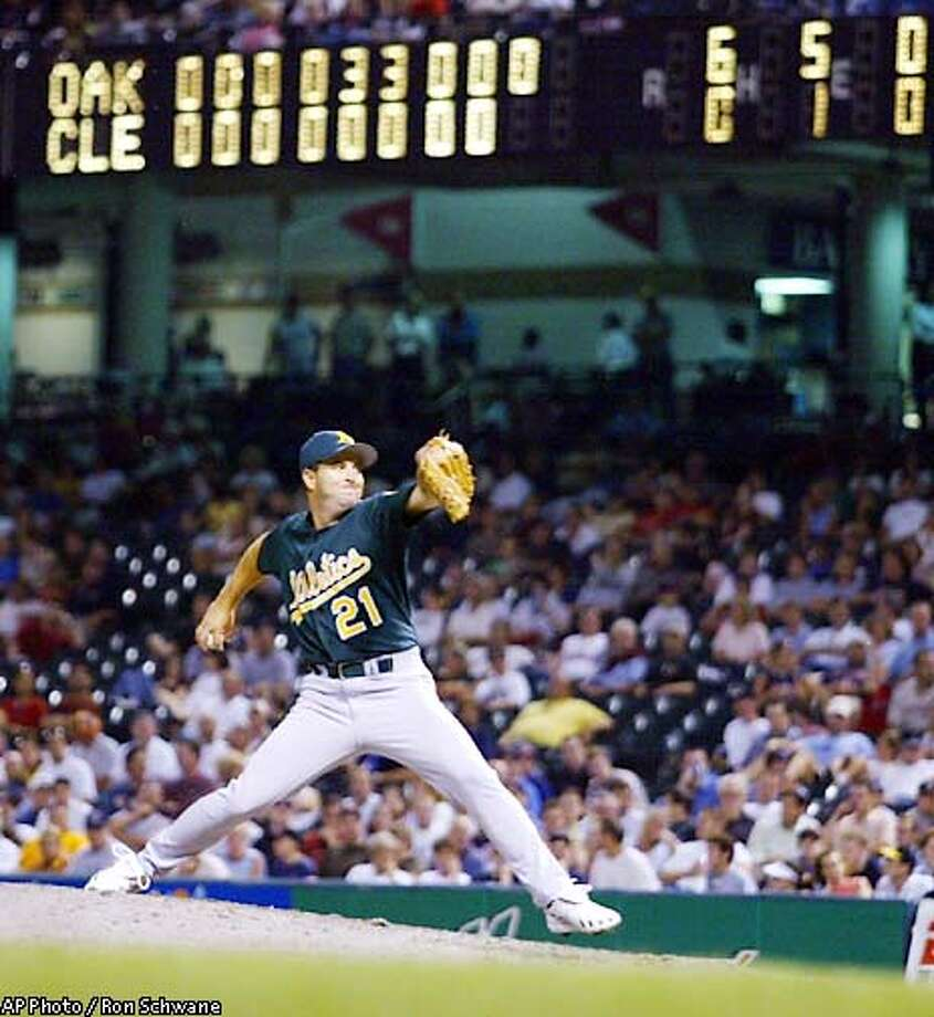 Corey Lidle (7-9) pitches to Cleveland Indians batter Coco Crisp in the ninth inning Wednesday, Aug. 21, 2002 at Jacobs Field in Cleveland. Lidle pitched a complete one-hitter game for the Athletics 6-0 win over the Indians. (AP Photo/Ron Schwane) Photo: RON SCHWANE