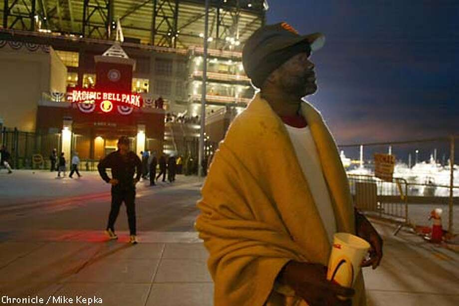 While Game 4 of the World Series plays out at Pacific Bell Park, panhandler Gregory Jordan stands vigil outside, hoping to pick up some spare change from happy Giants fans. Chronicle photo by Mike Kepka
