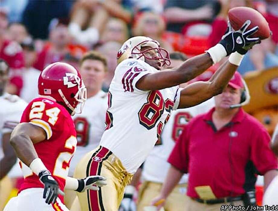 San Francisco 49ers' wide receiver J.J. Stokes (83) catches a pass in front of Kansas City Chiefs' cornerback William Bartee (24) in the first quarter at 3COM Park in San Francisco, Saturday, Aug. 10, 2002. (AP Photo/John Todd) Photo: JOHN TODD