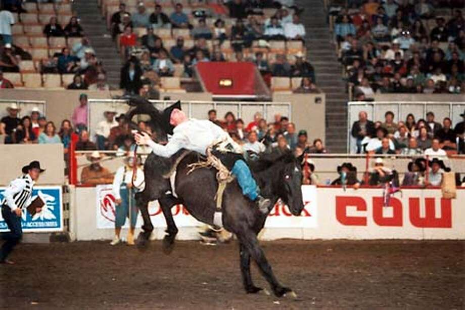 Rousing rodeo action, elegant Grand Prix Horse Show, over 1000 head of livestock on display are among the many highlights to be found at the 58th Grand National Rodeo, Horse and Stock Show set October 25 through November 3 at the Cow palace in San Francisco.  (HANDOUT PHOTO) Photo: HANDOUT