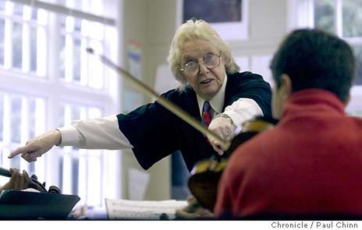 CROWDEN2-C-24APR03-DD-PC School founder and director Anne Crowden worked with Sasha Rosenthal during a rehearsal. The Crowden School combines music instruction with a regular school curriculum for 79 students between 4th and 8th grades. PAUL CHINN/SF CHRONICLE