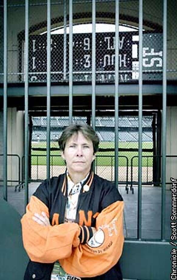"""Giants fan Kathie Ralph stands outside Pacific Bell Park near the """"knothole area"""" beyond right field. She is angry that Major League Baseball may have a work stoppage this year. (SF CHRONICLE PHOTO BY SCOTT SOMMERDORF) Photo: SCOTT SOMMERDORF"""