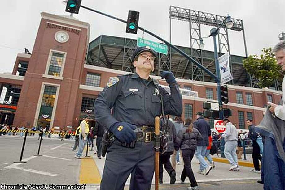 San Francisco police patrolman Kevin Martin works Second and King streets. The San Francisco Giants play the Anaheim Angels in Game 3 of the World Series at Pac Bell Park in San Francisco, Ca., October 22, 2002. Scott Sommerdorf/San Francisco Chronicle Photo: Scott Sommerdorf