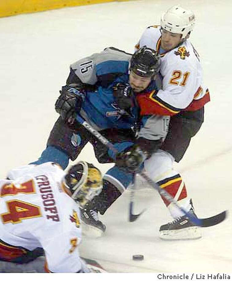 San Jose Sharks vs. Calgary Flames western conference division during the first period. Andrew Ference hold back Wayne Preimeau during the first period. Shot on 5/9/04 in San Jose. LIZ HAFALIA / The Chronicle Photo: LIZ HAFALIA