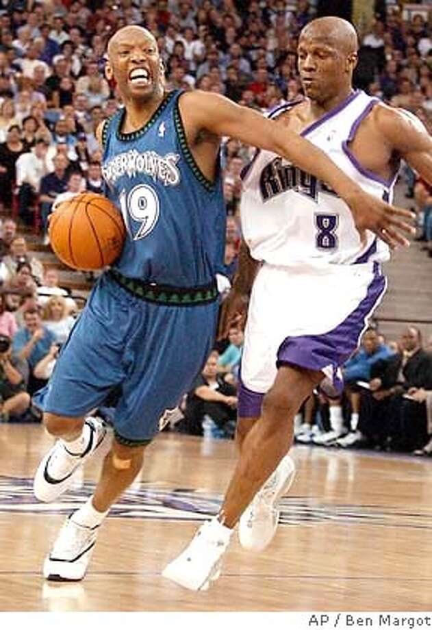 Minnesota Timberwolves' Sam Cassell, left, drives in front of Sacramento Kings' Anthony Peeler (8) in the first half of Game 3 of their NBA Western Conference semifinal series Monday, May 10, 2004, in Sacramento, Calif. (AP Photo/Ben Margot) Photo: BEN MARGOT