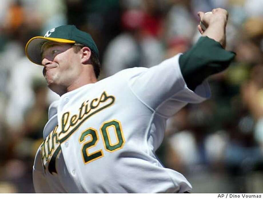 Oakland Athletics' Mark Mulder works against the Minnesota Twins Sunday, May 9, 2004, in Oakland, Calif. Mulder (3-2) went the distance, pitching a six-hitter in an 8-4 win. (AP Photo/Dino Vournas) Photo: DINO VOURNAS