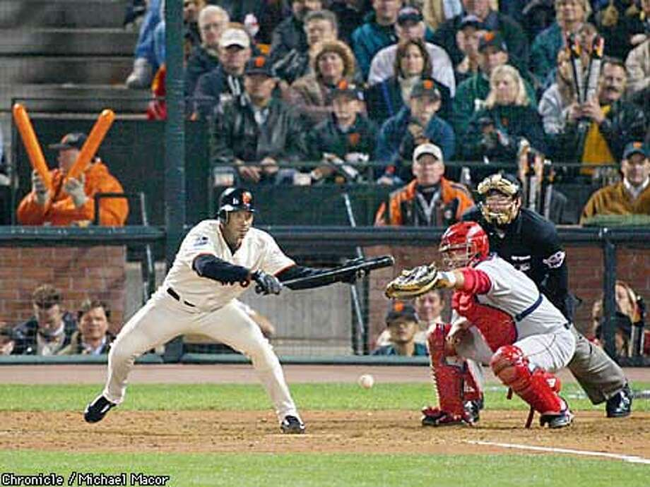 Giants Kenny Lofton lays down a bunt that remains fair in the fifth inning. The San Francisco Giants play the Anaheim Angels in Games 4 of the World Series at Pac Bell Park in San Francisco, Ca. October 23, 2002. Michael Macor/San Francisco Chronicle Photo: Michael Macor