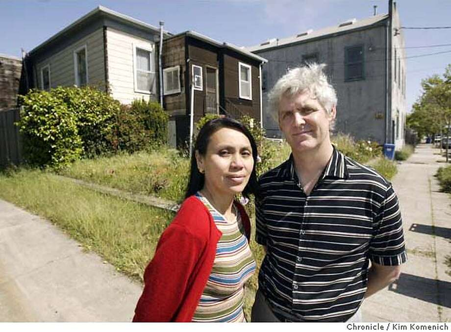 Elizabeth Miranda and Tim Rempel are a husband wife who are trying to build a small apartment building in West Berkeley. Neighbors say the small, dilapidated house currently on the site (Left) was built in 1878 and is worthy of protection as a historic cultural asset. (Their office is in the grey building on the right) Chronicle photo by Kim Komenich in Berkeley. Photo: Kim Komenich