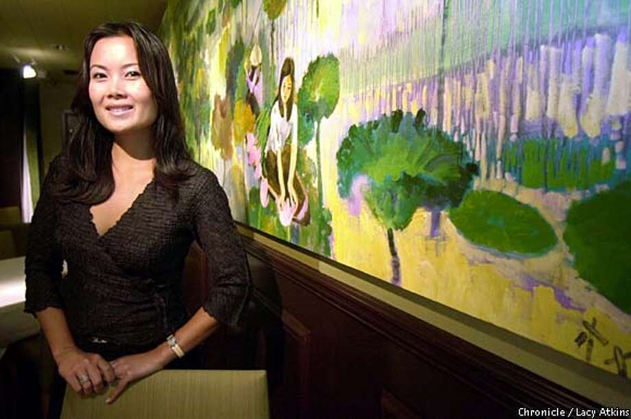 Food and Art: Anne Le, one of the owners of Tamarine in Palo Alto, brings art from Vietnam to hang in the restaurant. Chronicle photo by Lacy Atkins