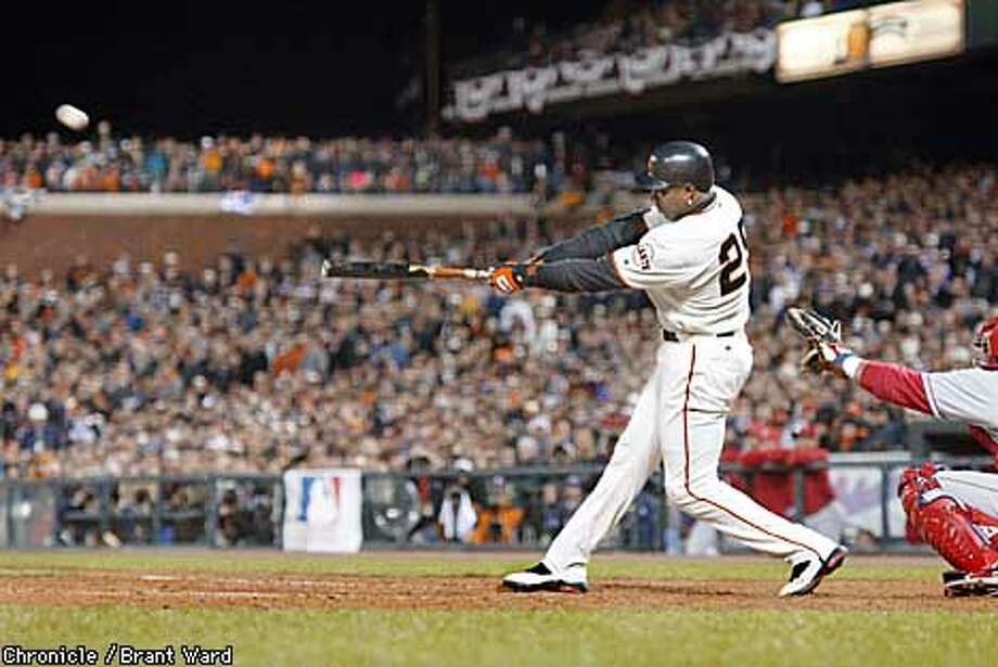 .jpg--- Barry Bonds connects on this 5th inning home run to make the score 8-4. The San Francisco Giants play the Anaheim Angels in Game 3 of the World Series at Pac Bell Park in San Francisco, Ca., October 22, 2002. Brant Ward/San Francisco Chronicle Photo: Brant Ward