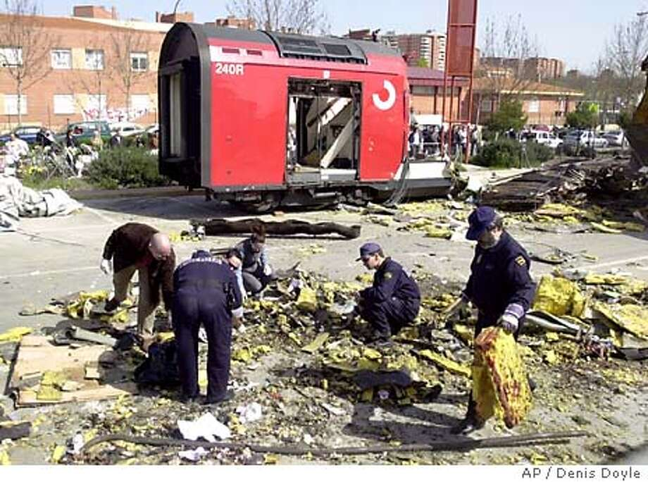 Police search for clues from the debris of one of the train bombings in the Madrid suburb of El Pozo Monday March 15, 2004. Authorities are investigating whether the terrorist bombings in Madrid and in Casablanca last year may be linked, focusing on a Moroccan who was arrested in Spain over the weekend, a Moroccan official told The Associated Press March 15 on condition of anonymity. (AP Photo/Denis Doyle) Rodriguez Zapatero Photo: DENIS DOYLE