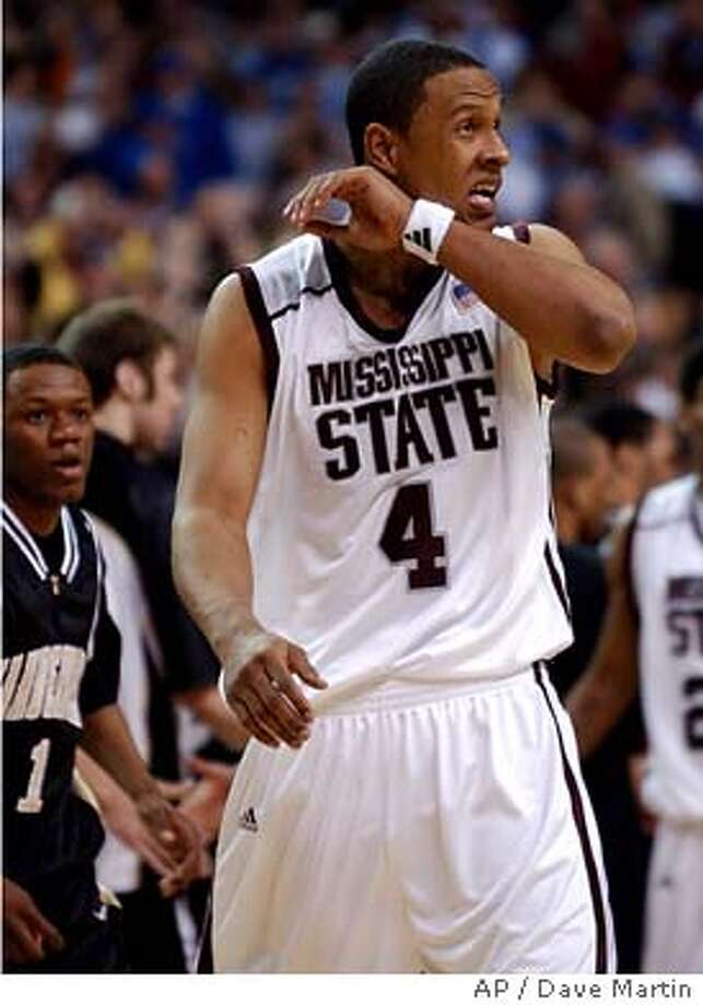 Mississippi State's Lawrence Roberts (4) wipes his face as he walks off the court as Vanderbilt's Mario Moore (1) looks on at the SEC basketball tournament in the Georgia Dome in Atlanta Friday, March 12, 2004. Vanderbilt defeated Mississippi State 74-70. (AP Photo/Dave Martin) Photo: DAVE MARTIN