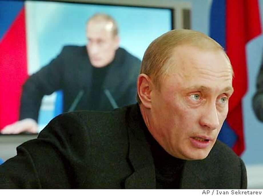 Russian President Vladimir Putin makes his victory speech during a news conference in Moscow early Monday, March 15, 2004. Putin said early Monday that Russia will analyze U.S. officials' criticism of the presidential election that gave him a landslide victory but sought to turn the tables on Washington by saying U.S. election procedures were imperfect too. (AP Photo/Ivan Sekretarev) Photo: IVAN SEKRETAREV