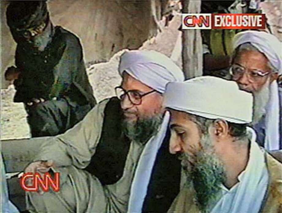 This view from from undated video showing Osama bin Laden is part of a cache of videotapes that CNN acquired in Afghanistan which purport to show al-Qaida terror training, bomb-making and poison gas experiments in which dogs die agonizing deaths. The tapes that began airing Sunday, Aug. 18, 2002, also show al-Qaida operatives appear to be practicing ambushes and kidnapping. Most of the tapes appear to be made before Sept. 11, although some show television coverage of the attacks in New York and Washington. (AP Photo/Courtesy of CNN)