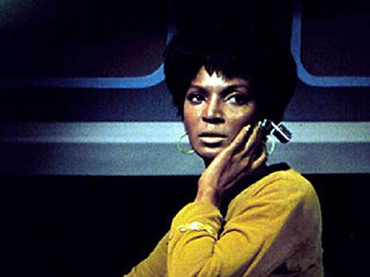 Star Trek's Uhura uses a wireless earpiece to listen to communications. Event on 3/11/04 in . / HO