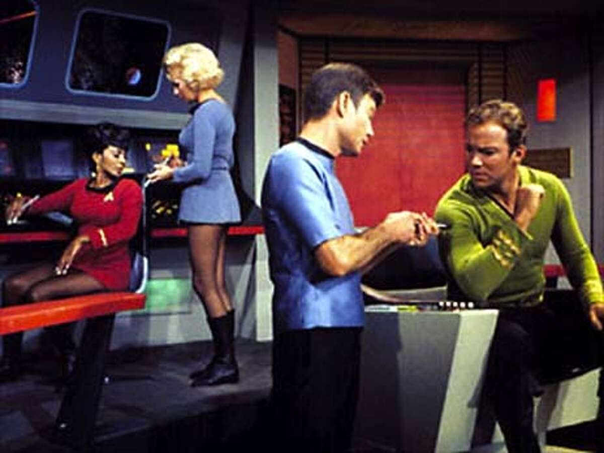Bones injects Kirk with a hypospray on Star Trek. Event on 3/11/04 in . / HO
