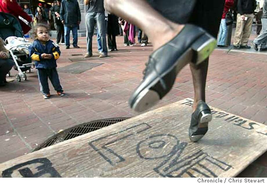 Event on 3/5/04 in San Francisco.  Edward Jackson does a spirited tap dance, enthralling young (NAME TK) in front of the Powell Street cable car turntable. Jackson is one of the legion of performers who beguile and bore pedestrians on the streets San Francisco. Chris Stewart / The Chronicle Photo: Chris Stewart